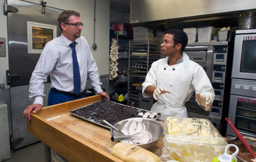 Minister of Home Affairs, Sen. the Hon. Michael Fahy, JP, met with Markus Raynor-Brangman, 22, who is currently enrolled in the Government's Summer Employment Programme working as a trainee pastry chef at The Reefs. *Photo supplied
