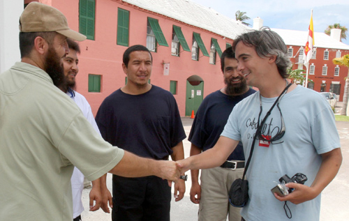 First meeting: James Whittaker greets the four Uyghurs who arrived in Bermuda from Guantanamo Bay. *Bermuda Sun file photo